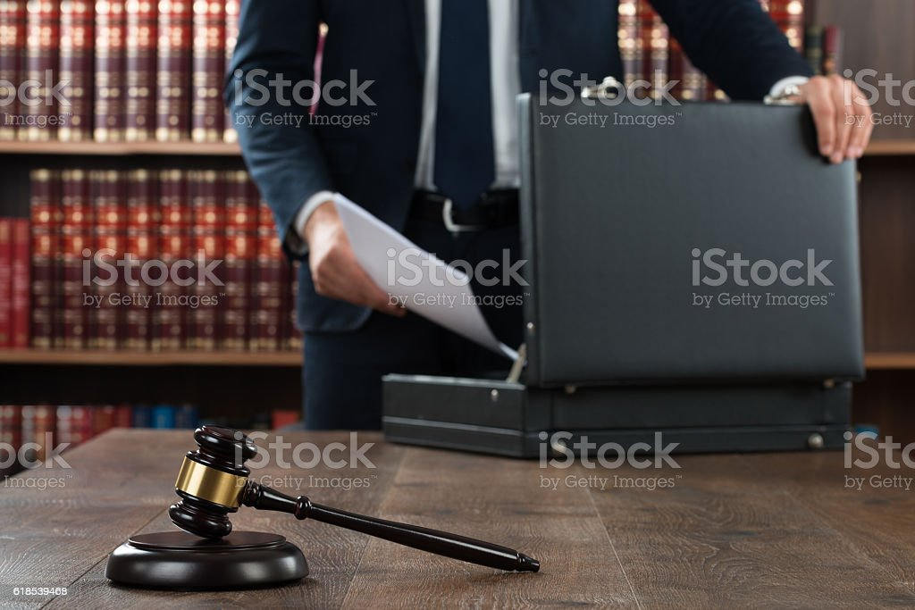 Lawyer Putting Documents In Briefcase stock photo
