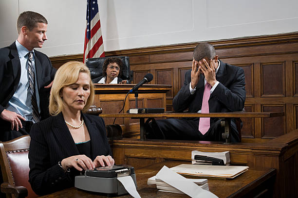 a lawyer questioning a suspect - four lawyers stockfoto's en -beelden