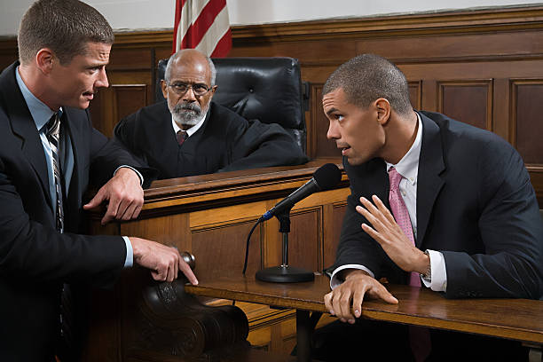 A lawyer questioning a suspect  courtroom stock pictures, royalty-free photos & images