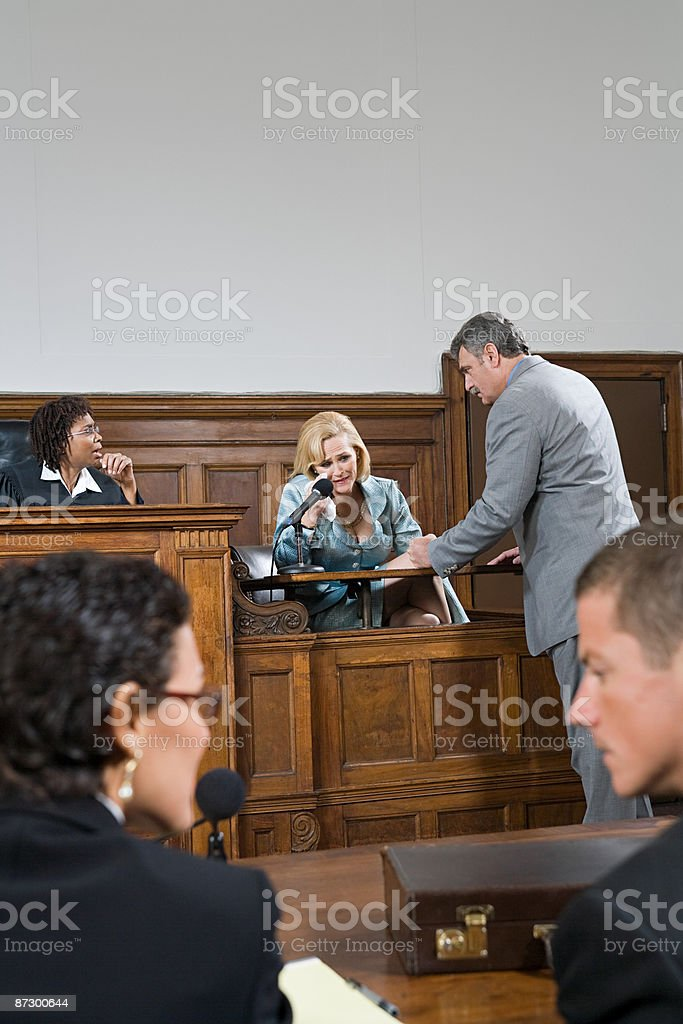 A lawyer questioning a witness stock photo