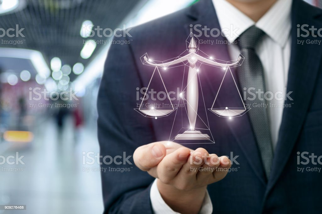 Lawyer shows the scales of justice in hand . stock photo
