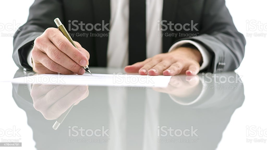 Lawyer signing document stock photo