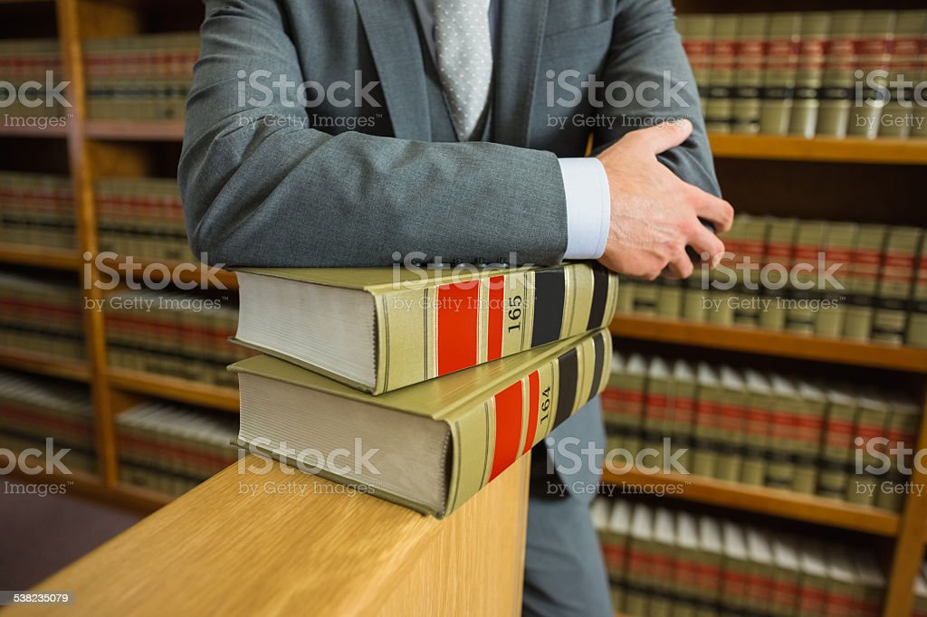 Lawyer standing in the law library stock photo