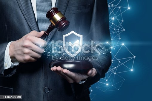 istock A lawyer with a juridical gavel and a shield with quality sign inside. 1146233255