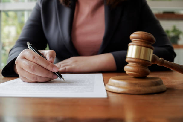 Lawyer with legal contract signing in law firm. stock photo