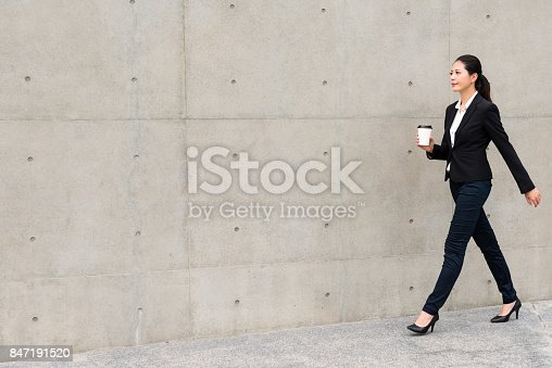 istock lawyer woman confident walking on outdoor 847191520