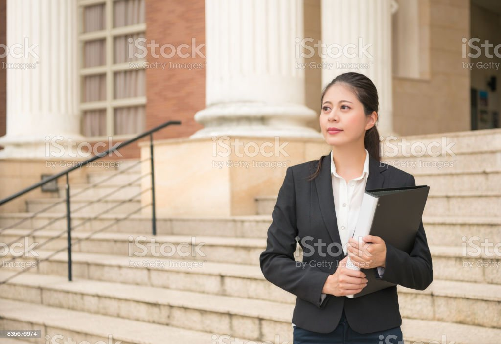 lawyer woman standing in front of the court stock photo