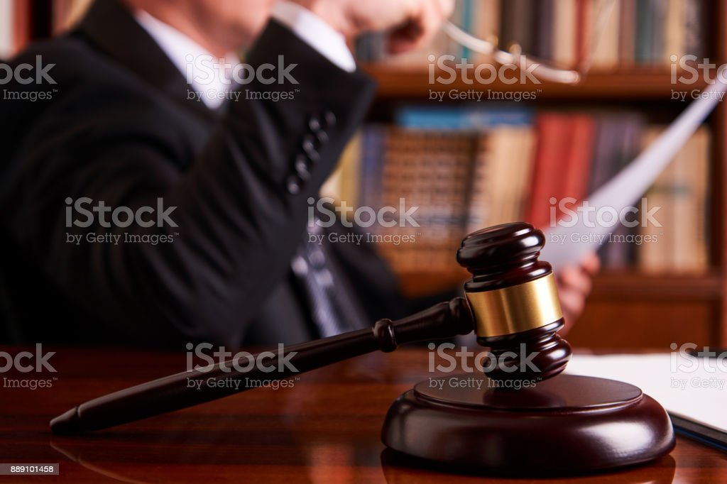 Lawyer working, holding Law document stock photo