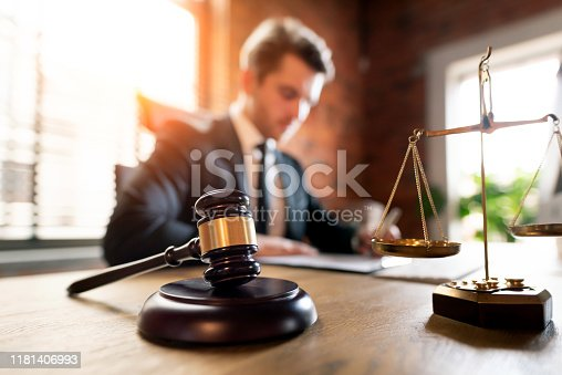 Lawyer or attorney working in office. Law and justice concept