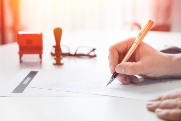 Lawyer working in office. Notary signs document stock photo