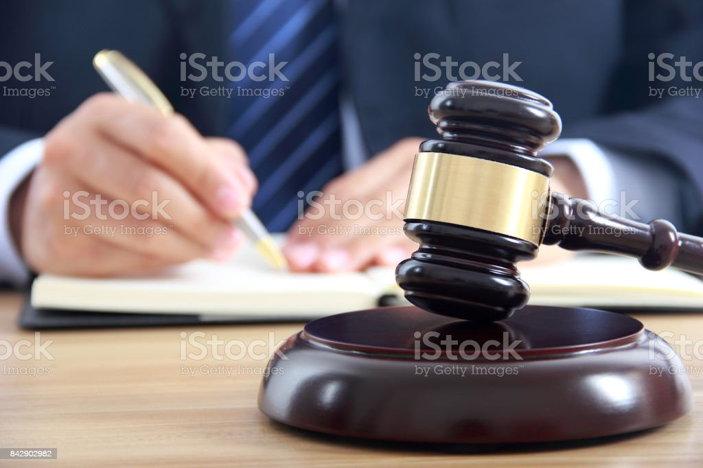 Lawyer working with gavel stock photo