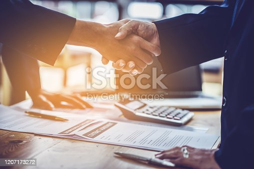 836113188 istock photo Lawyers and businessmen join hands in business After signing the legal consultancy contract 1207173272