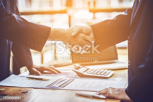 836113188 istock photo Lawyers and businessmen join hands in business After signing the legal consultancy contract 1225930551