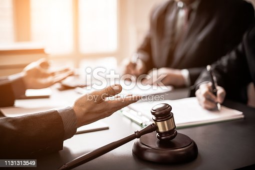 istock Lawyers consulted on various lawsuits. 1131313549