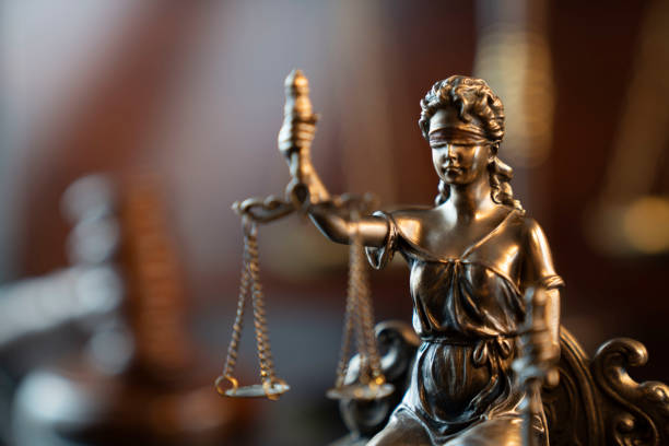 Lawyers office concept Law symbols composition: gavel, scale and Themis statue. jurist stock pictures, royalty-free photos & images