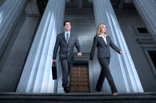 Lawyers Or Business People Leaving Courthouse stock photo
