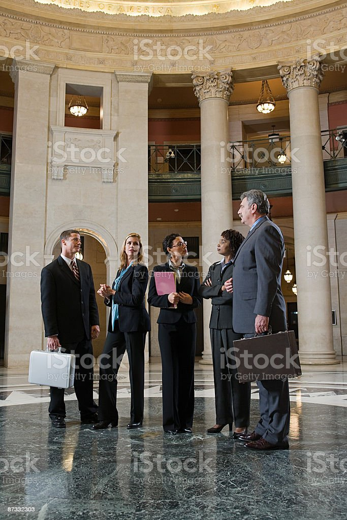 Lawyers talking in a courthouse royalty-free stock photo