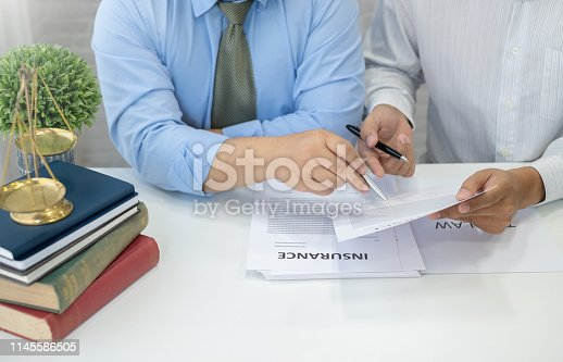 941906652 istock photo Lawyers team discuss legal matters to assist clients in legal litigation. 1145586505