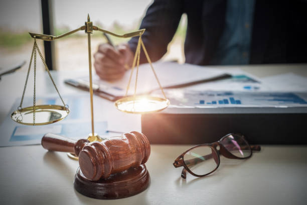 Lawyers working with brass scale on wooden desk in office at background. Law, legal services, advice, Justice concept. Lawyers working with brass scale on wooden desk in office at background. Law, legal services, advice, Justice concept. jurist stock pictures, royalty-free photos & images