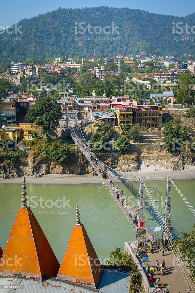 Laxman Jhula bridge over Ganges river in Rishikesh, India stock photo