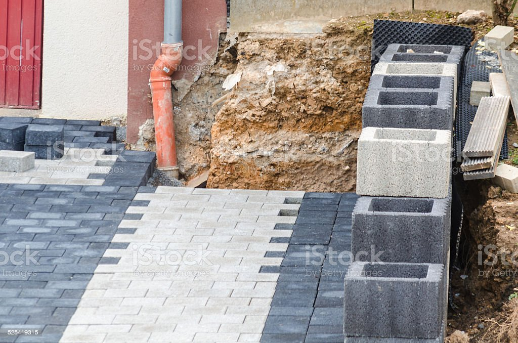 Lay Paving Stones stock photo