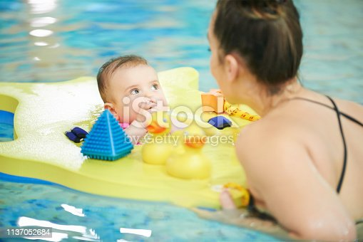 Shot of babies learning to swim in an indoor pool