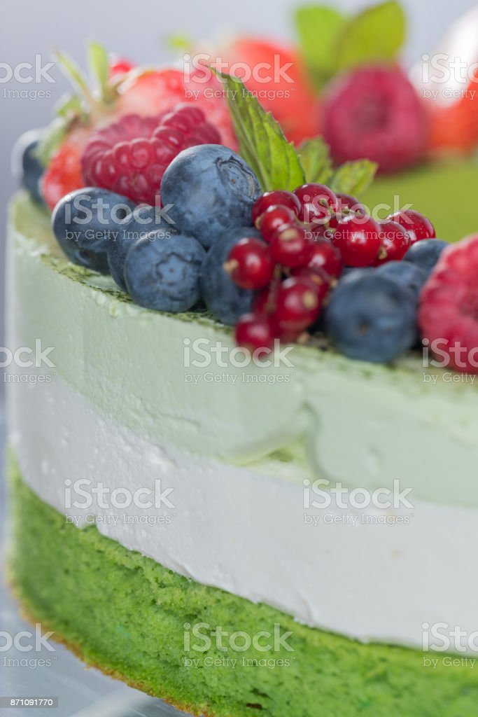 Layer cake garnished with berry fruit stock photo