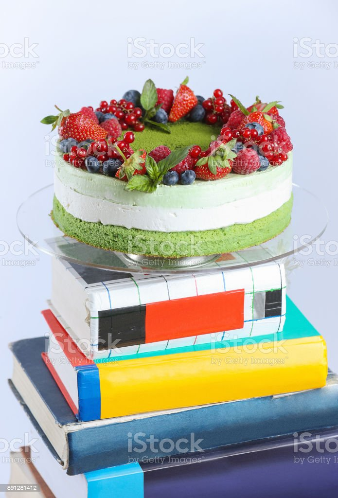 Layer cake on pile of books stock photo