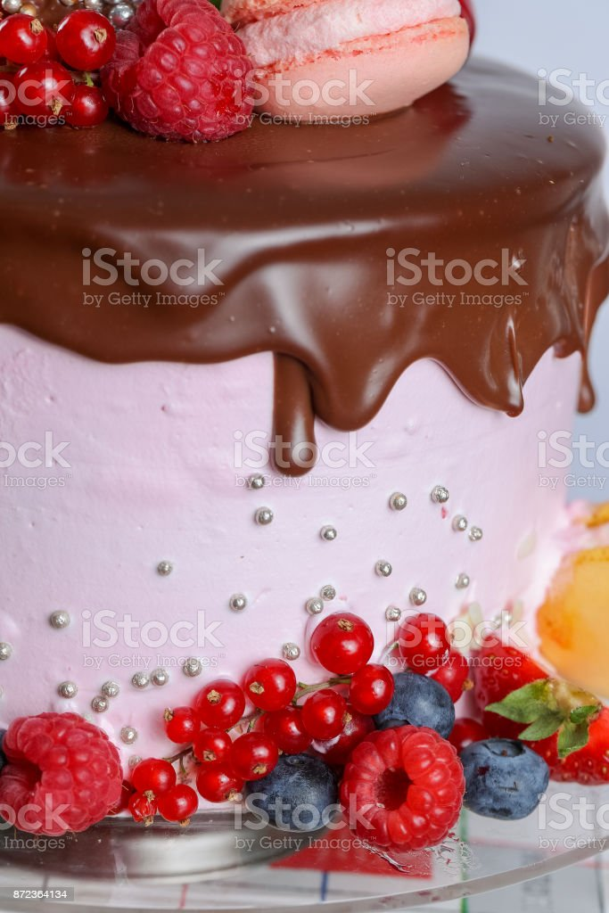 Layer cake with chocolate icing stock photo