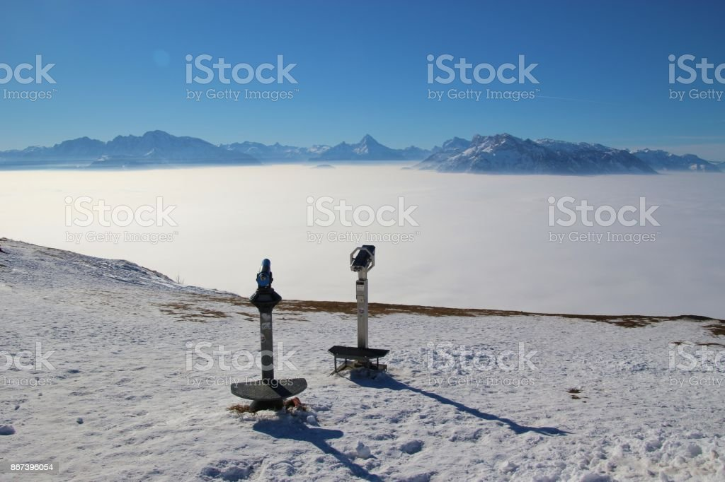 A layer of high fog above the valley of Salzburg, Austria, in winter. stock photo