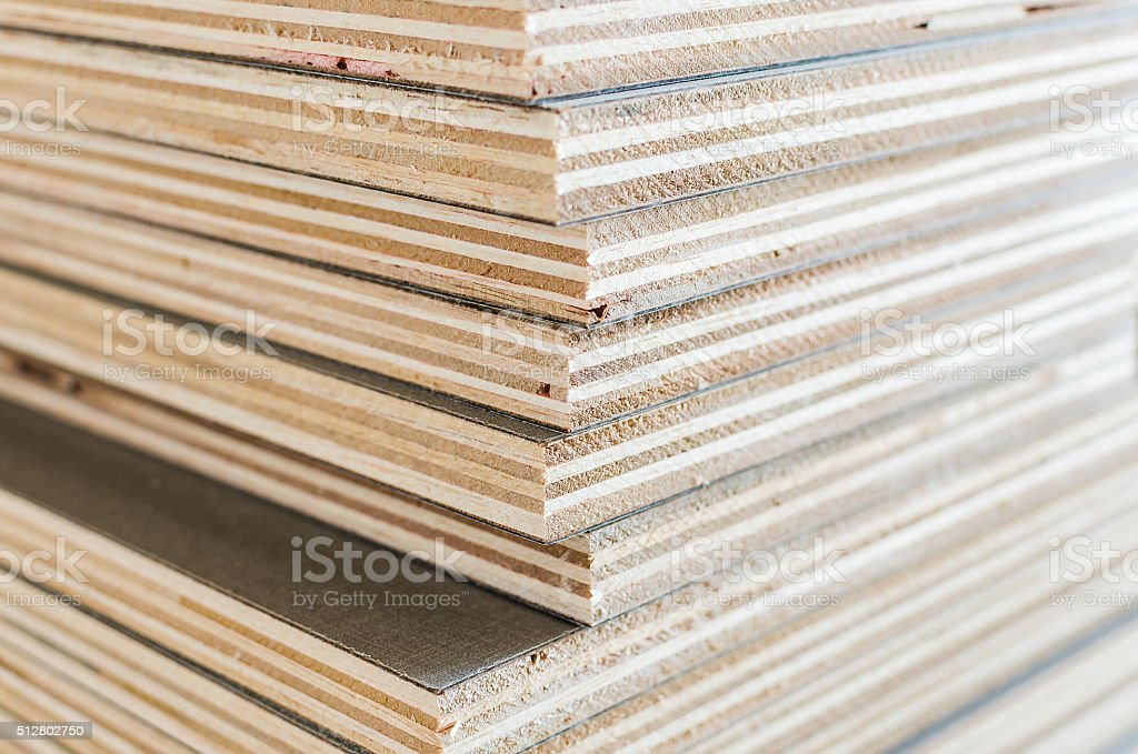 layer of plywood in construction site stock photo