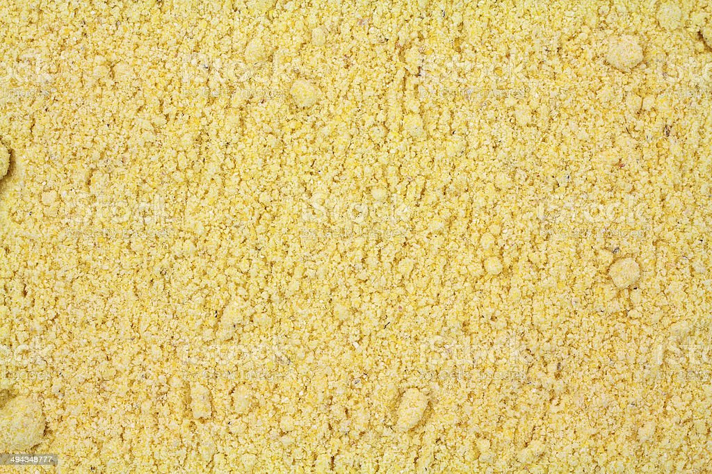 Layer of stone ground yellow corn meal stock photo