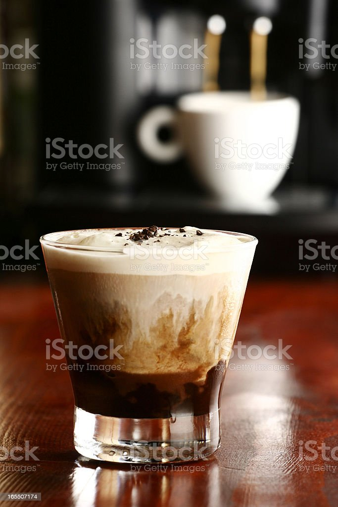 Layered coffee drink on wood bar stock photo