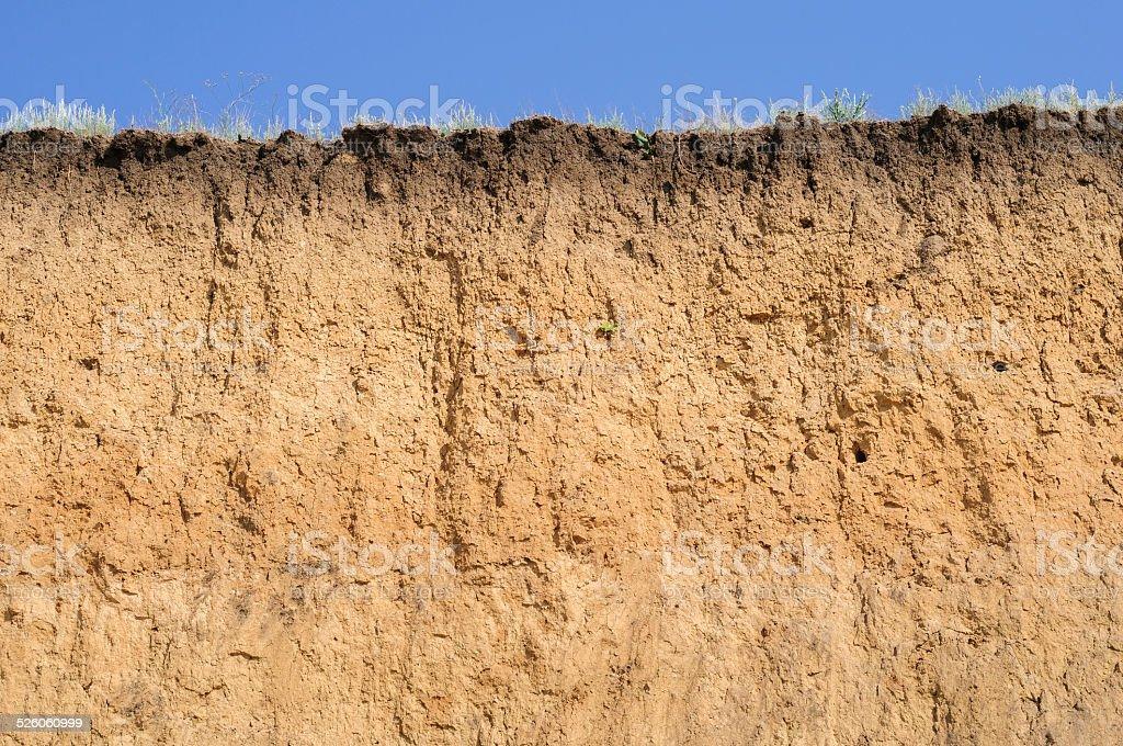 Layered cut of soil stock photo