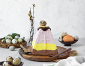 Layered paskha with chocolate, berries and curcuma. Traditional Russian or Ukrainian orthodox Easter quark dessert. Easter food background.