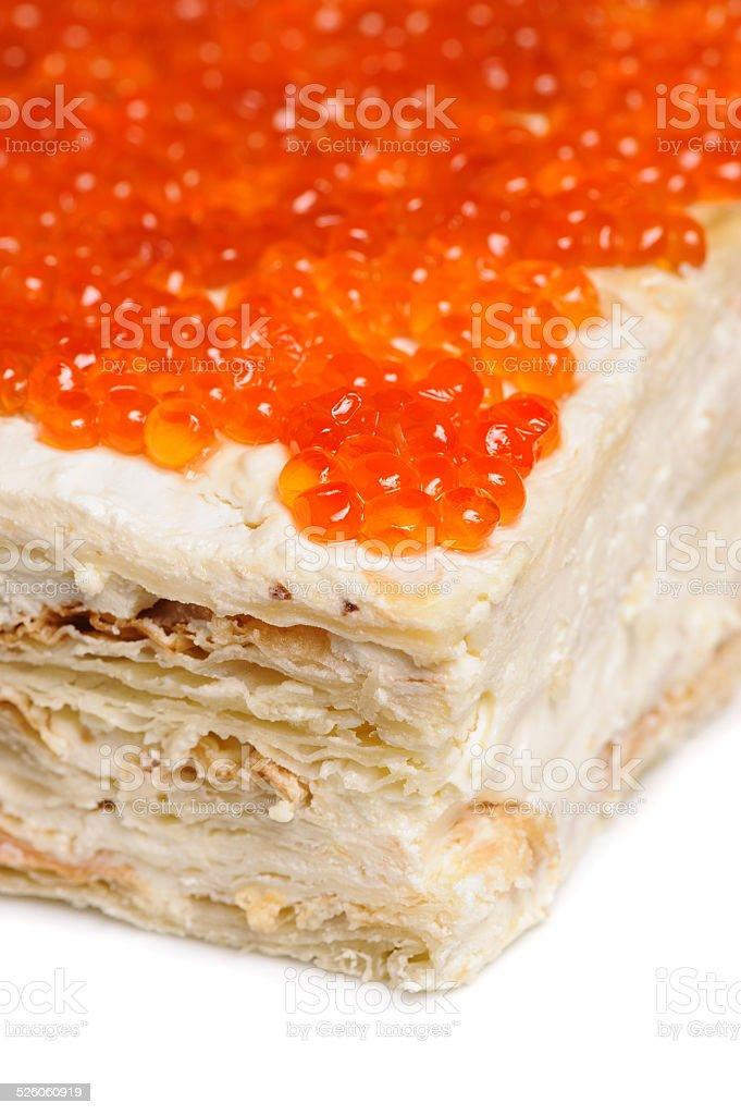layered red caviar pie stock photo