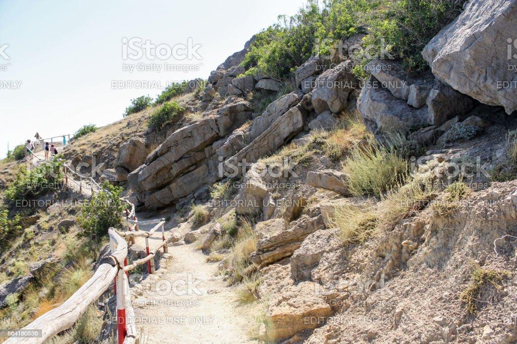 Layered rock along the path. royalty-free stock photo