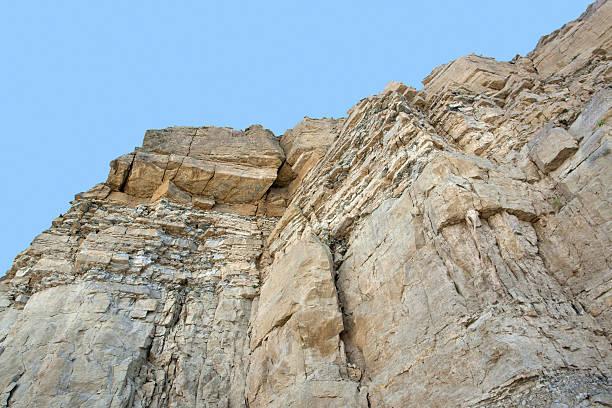 layered rock face stock photo