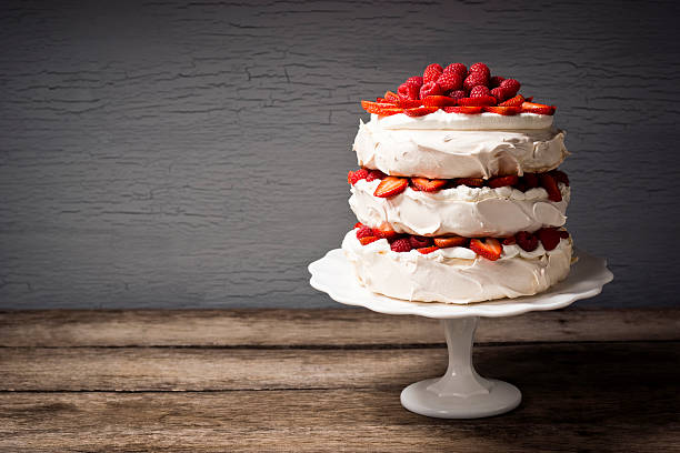 layered strawberry and raspberry pavlova with copy space - cake stock photos and pictures