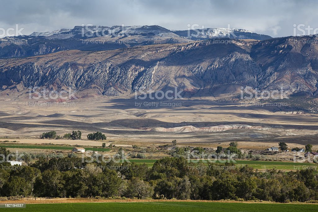 Layered Western Landscape With Mountain Range, Green Trees, Plain royalty-free stock photo