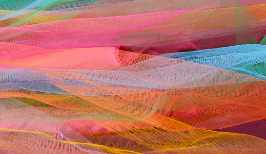 Layers of Bright Colorful Tulle Netting with Pink Sequin