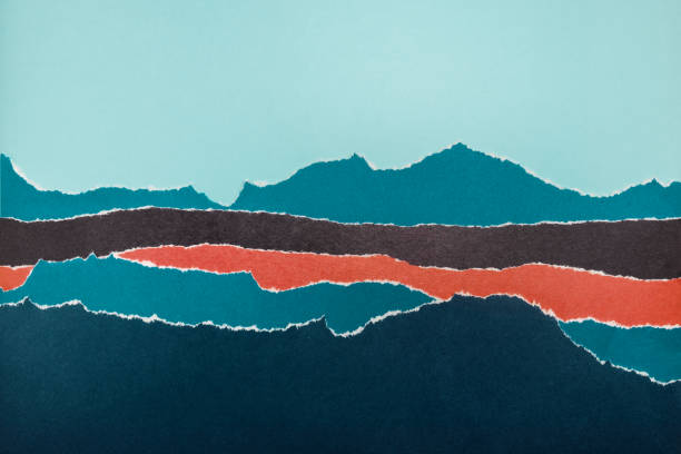 Layers of colored paper with torn edges. stock photo