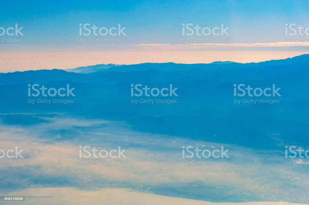 Layers of mountain from airplane top view stock photo