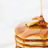 istock layers Pancakes with Honey Syrup 1214416733