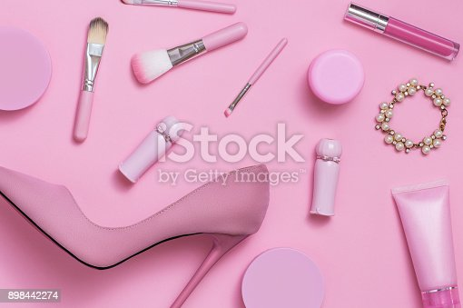 istock Layflat image of pink womans fashion and cosmetics products. 898442274