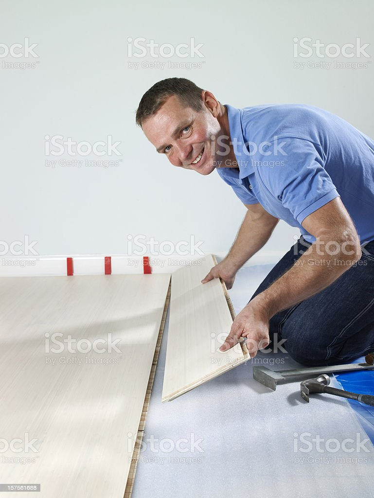 Laying a floor stock photo