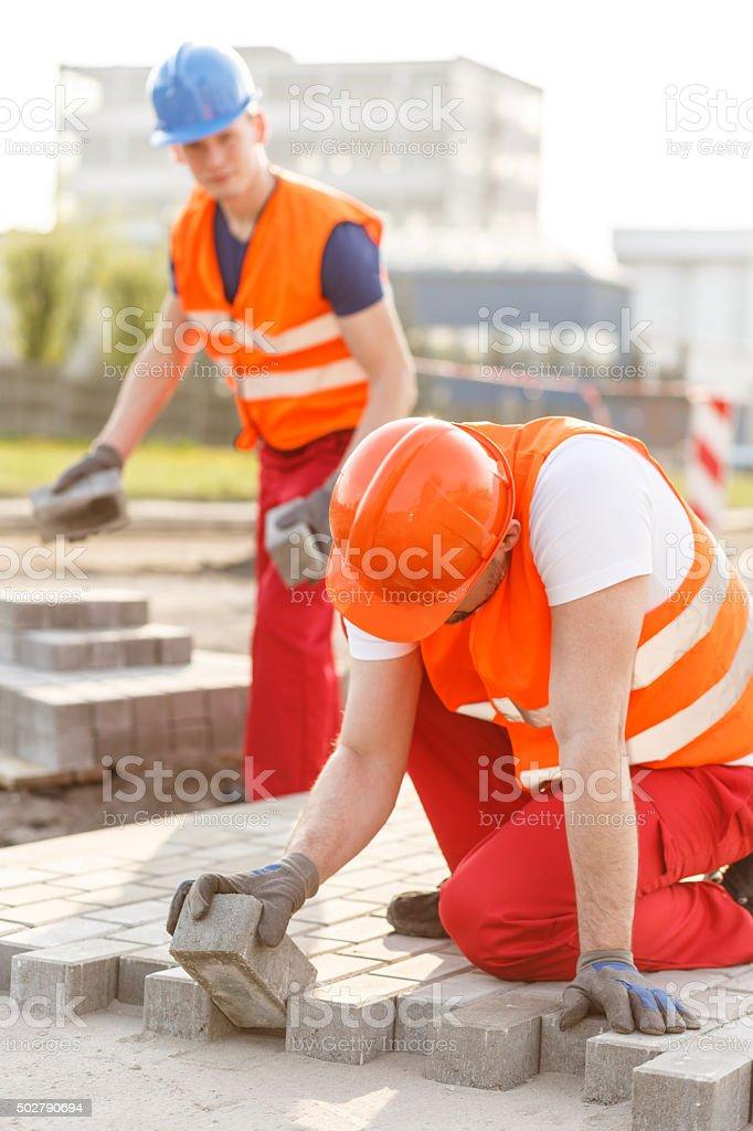 Laying a pavement stock photo
