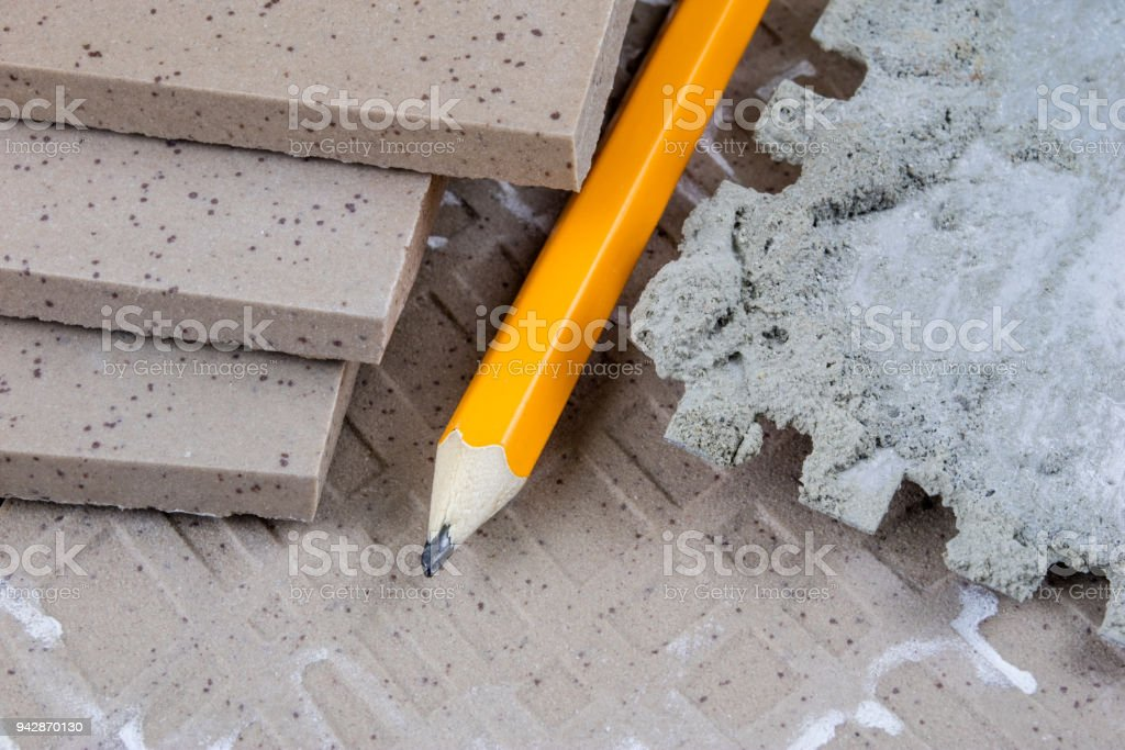 Laying And Cutting Tiles Tools And Building Materials At A Working