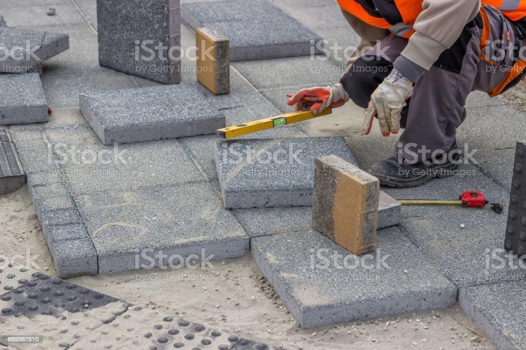 Laying brick pavers stock photo