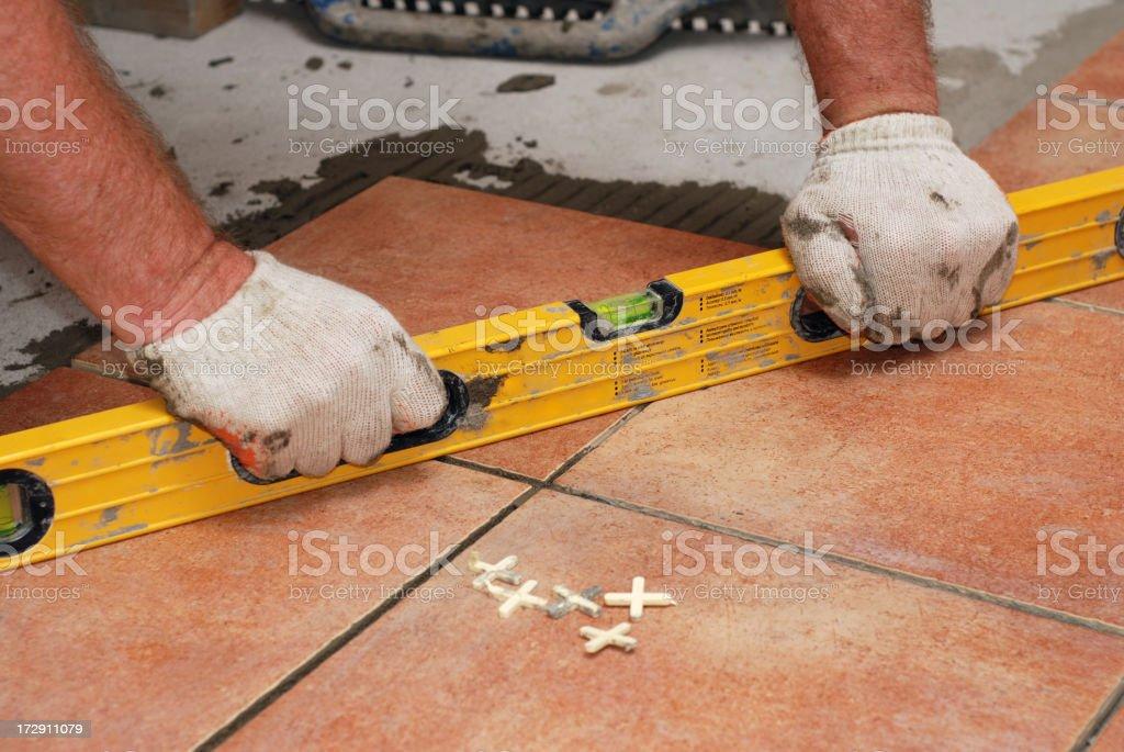 Laying Ceramic Tiles 1 royalty-free stock photo